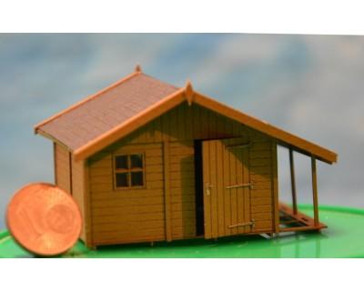 Cabane avec bûcher